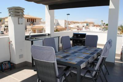 Top floor apartment in Oasis Beach Punta Prima 7 Nº 018 in España Casas