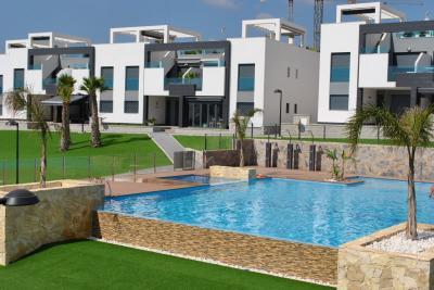 Top floor apartment in Oasis Beach Punta Prima 7 Nº 032 in España Casas